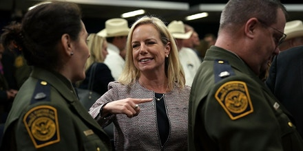 U.S. Secretary of Homeland Security Kirstjen Nielsen, center, greets members of U.S. Border Patrol after an event with 'Angel Families' on June 22, 2018, in Washington, D.C.