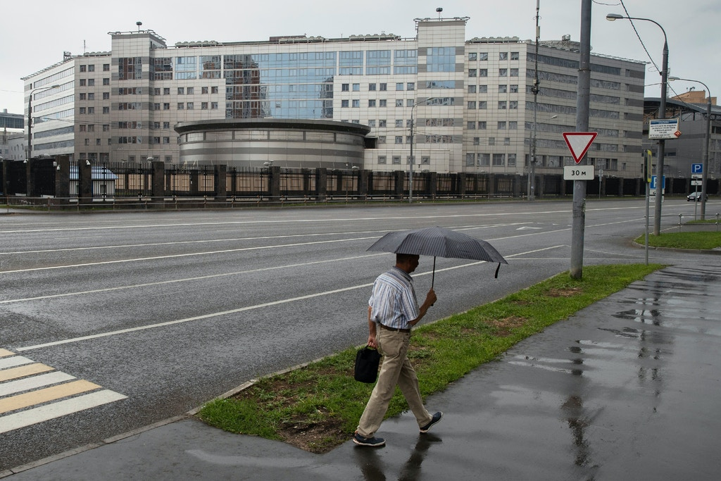 A man walks past the building of the Russian military intelligence service in Moscow, Russia, Saturday, July 14, 2018. Twelve Russian military intelligence officers hacked into the Clinton presidential campaign and Democratic Party and released tens of thousands of private communications in a sweeping conspiracy by the Kremlin to meddle in the 2016 U.S. election, according to an indictment announced days before President Donald Trump's summit with Russian President Vladimir Putin. (AP Photo/Pavel Golovkin)Russia
