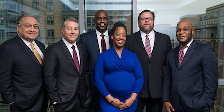 From left to right: Joe Velazquez, Sam Geduldig, David Morgan, Jennifer Stewart, Jim Terry, and Michael Williams, photographed at the UBI office in Washington, D.C., in Dec. 2017.