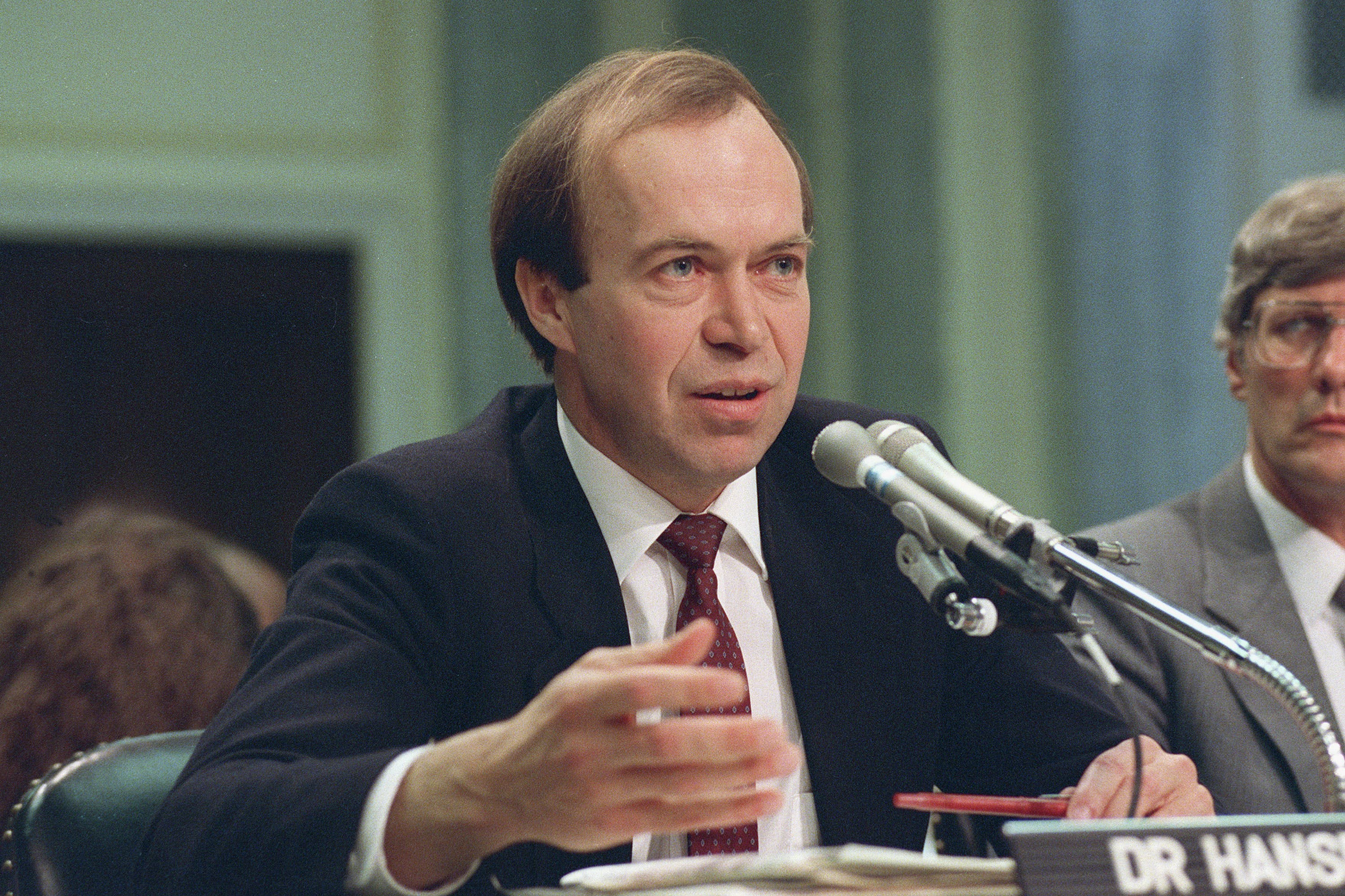 FILE - In this May 9, 1989 file photo, Dr. James Hansen, director of NASA's Goddard Institute for Space Studies in New York, testifies before a Senate Transportation subcommittee on Capitol Hill in Washington, D.C., a year after his history-making testimony telling the world that global warming was here and would get worse. (AP Photo/Dennis Cook, File)