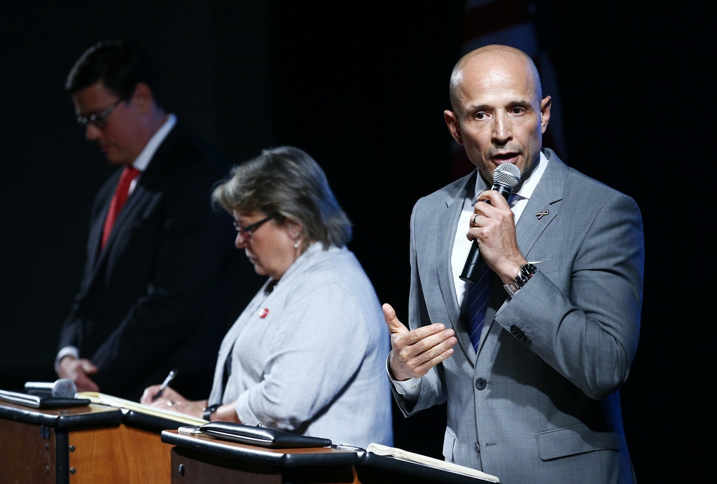 Democratic Arizona gubernatorial candidate David Garcia, right, answers a question as he debates with other candidates, state Sen. Steve Farley, left, and Kelly Fryer, middle, at the Our Revolution AZ Valley of the Sun event Tuesday, July 10, 2018, in Scottsdale, Ariz. The three candidates hope to unseat Republican Gov. Doug Ducey in November. (AP Photo/Ross D. Franklin)