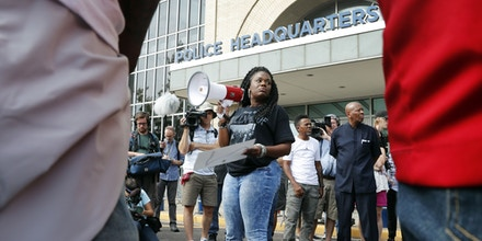 FILE - In this Sept. 17, 2017 file photo, Cori Bush speaks on a bullhorn to protesters outside the St. Louis Police Department headquarters in St. Louis. Few members of Congress are more entrenched than William Lacy Clay of St. Louis, but Bush, a once-homeless woman spurred to activism in Ferguson believes she could be the next Democrat to pull off a big primary upset. Bush watched in June as Alexandria Ocasio-Cortez shocked the political establishment by beating 10-term Rep. Joseph Crowley in the New York Democratic primary. Bush is optimistic heading into Missouri's Aug. 7 primary. (AP Photo/Jeff Roberson File)
