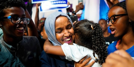 Minnesota Rep. Ilhan Omar celebrates with her children after her Congressional 5th District primary victory, Tuesday, Aug. 14, 2018, in Minneapolis. (Mark Vancleave/Star Tribune via AP)