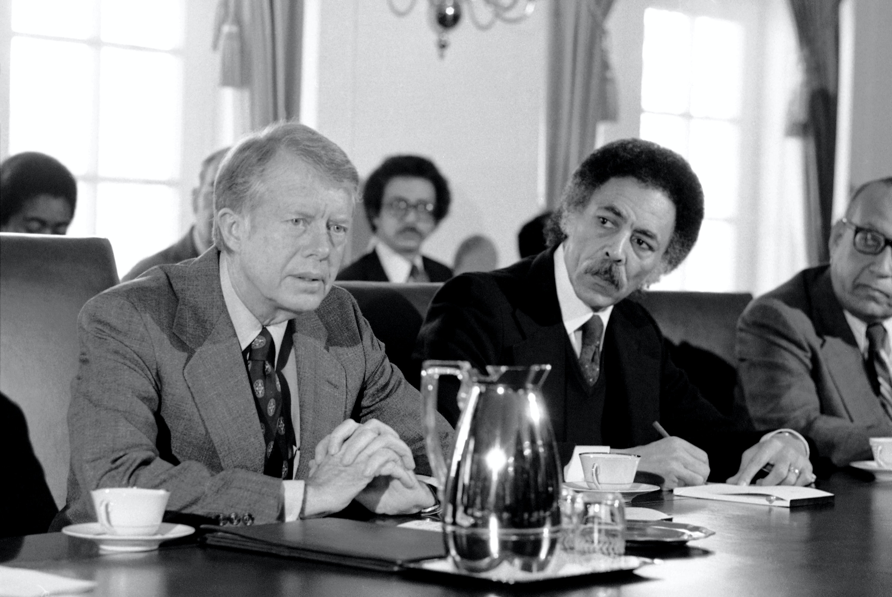 President Jimmy Carter meets with some of the members of the Congressional Black Caucus in Washington on Wednesday, Feb. 28, 1979. Rep. Ronald V. Dellums, D-Calif., is seated beside Carter. (AP Photo/Harvey Georges)