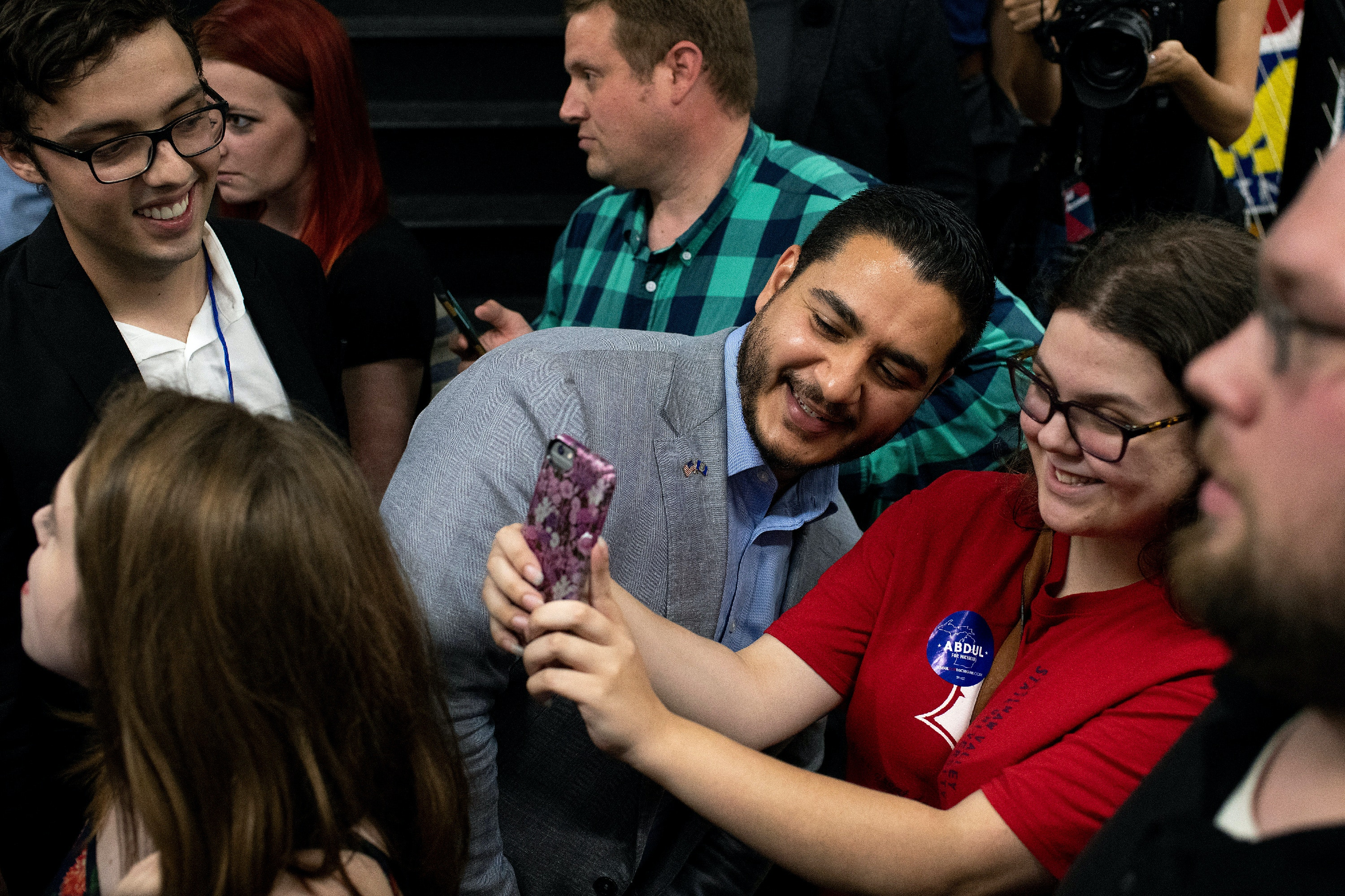 Michigan Democratic Gubernatorial candidate Abdul El-Sayed takes a photo with Rebecca Gillette, of Mount Morris, during his campaign rally with Alexandria Ocasio-Cortez at the Ferris Wheel building in Flint, Michigan on Saturday, July 28, 2018. (Rachel Woolf for The Intercept)