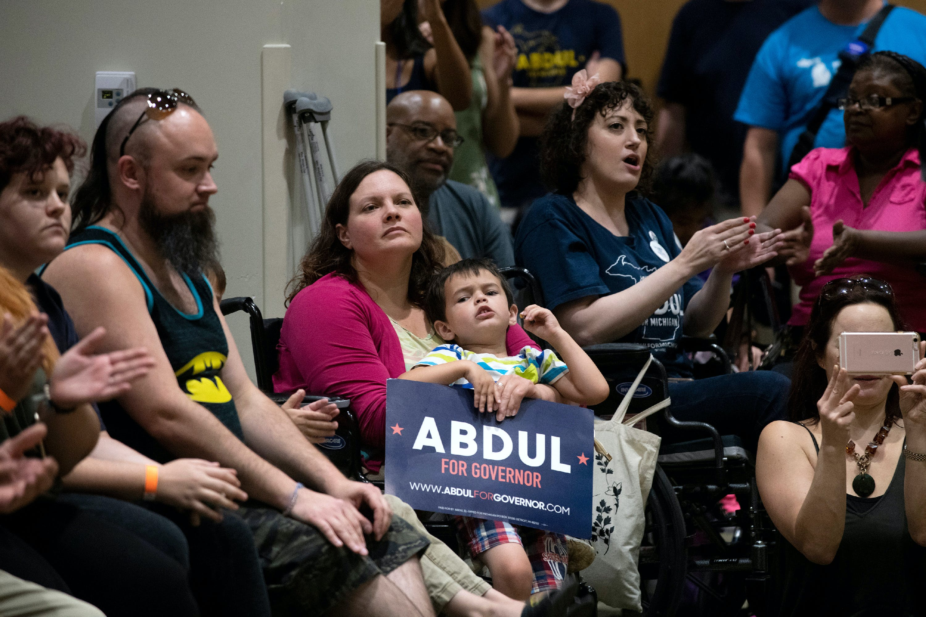 Supporters listen as Michigan Democratic Gubernatorial candidate Abdul El-Sayed speaks during his campaign rally with Alexandria Ocasio-Cortez at the Wayne State University Student Center in Detroit, Michigan on Saturday, July 28, 2018. (Rachel Woolf for The Intercept)