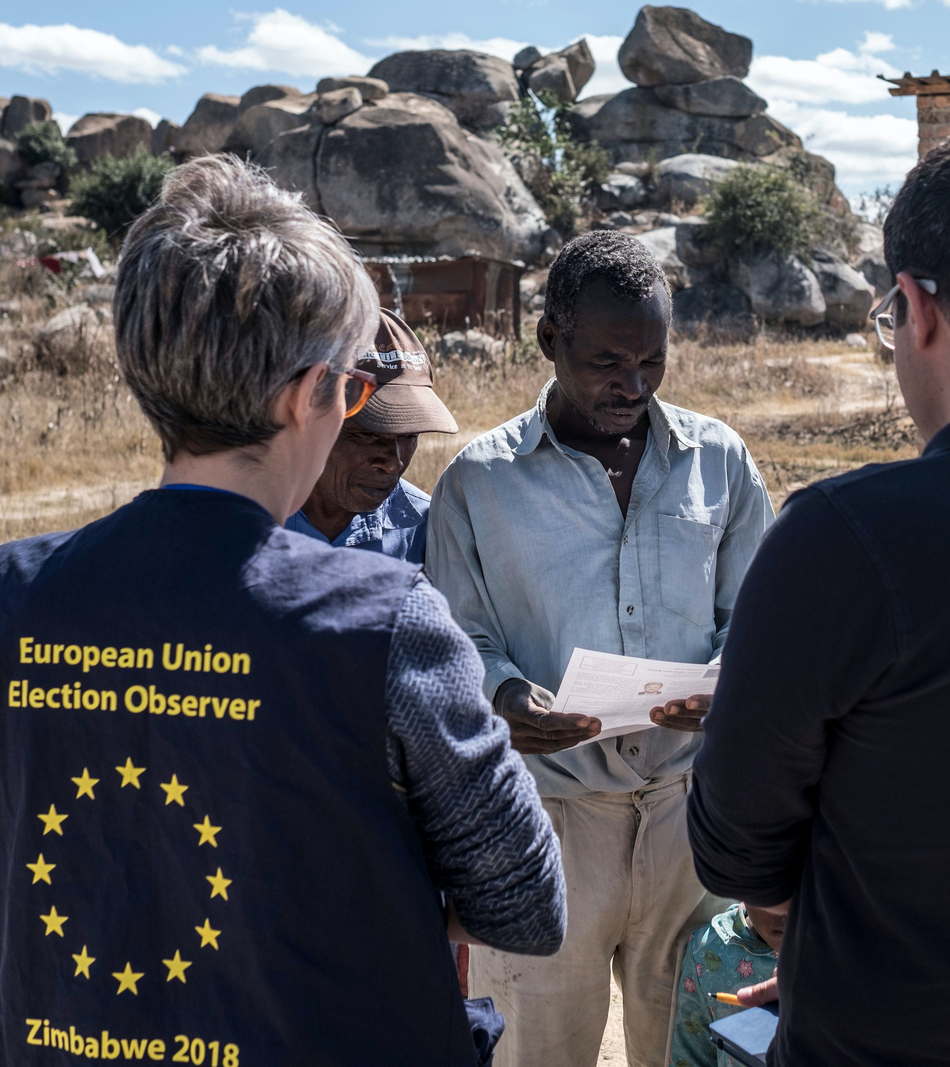 Members of a European Union election observation team speak to voters in Nyatsime, on July 24, 2018. - EU observers have been invited back into the country by the Zimbabwean Government for the first time after a key observer was expelled during the disputed 2002 presidential election. Zimbabwe will hold general elections on July 30, 2018. (Photo by MARCO LONGARI / AFP)        (Photo credit should read MARCO LONGARI/AFP/Getty Images)