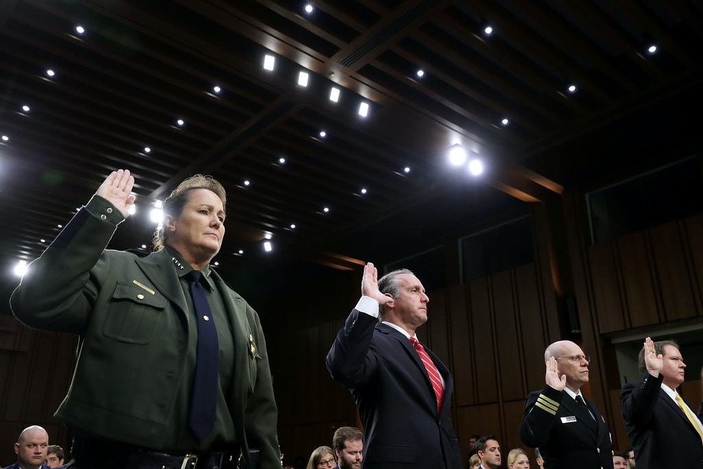 WASHINGTON, DC - JULY 31:  (L-R) U.S. Border Patrol acting Chief Carla Provost, Immigration and Customs Enforcement Executive Associate Director of Enforcement and Removal Operations Matthew Albence, commander of the U.S. Public Health Service Commissioned Corps Commander Jonathan White and U.S. Justice Department Executive Office For Immigration Review Director James McHenry are sworn in before testifying to the Senate Judiciary Committee in the Hart Senate Office Building on Capitol Hill July 31, 2018 in Washington, DC. The committee questioned the administration officials about the separation of children from their parents at the U.S.-Mexico border at the government's efforts to reunify those families.  (Photo by Chip Somodevilla/Getty Images)
