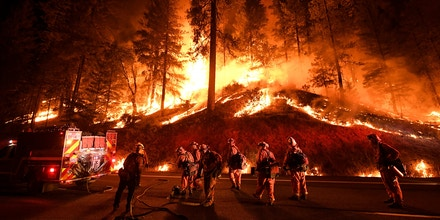 TOPSHOT - Firefighters try to control a back burn as the Carr fire continues to spread towards the towns of Douglas City and Lewiston near Redding, California on July 31, 2018. - Two firefighters were killed fighting the blaze and three people, a 70 year old woman and her two great-grandchildren age four and five, perished when their Redding home was rapidly swallowed up by flames. (Photo by Mark RALSTON / AFP)        (Photo credit should read MARK RALSTON/AFP/Getty Images)