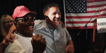 RACINE, WI - AUGUST 14:  Democratic congressional candidate Randy Bryce (R) celebrates with a supporter at an election-night rally after being declared the winner in the Wisconsin Democratic primary on August 14, 2018 in Racine, Wisconsin. Bryce will face Republican contender Bryan Steil for the congressional seat being vacated by retiring Speaker of the House Paul Ryan's (R-WI) in the upcoming general election.  (Photo by Scott Olson/Getty Images)
