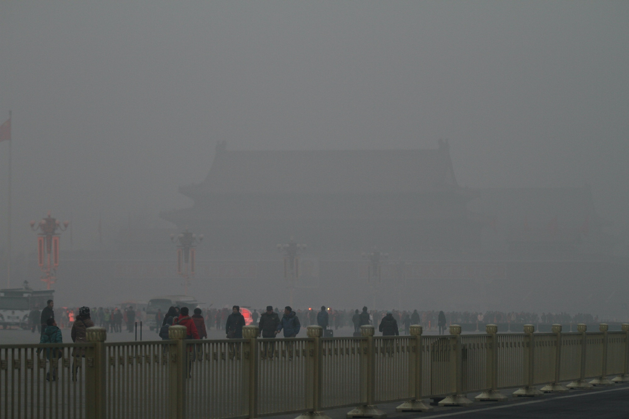 BEIJING, CHINA - JANUARY 16:  (CHINA OUT) People visit the Tiananmen Square which is shrouded with heavy smog on January 16, 2014 in Beijing, China. Beijing Municipal Government issued a yellow smog alert this morning.  (Photo by VCG/VCG via Getty Images)