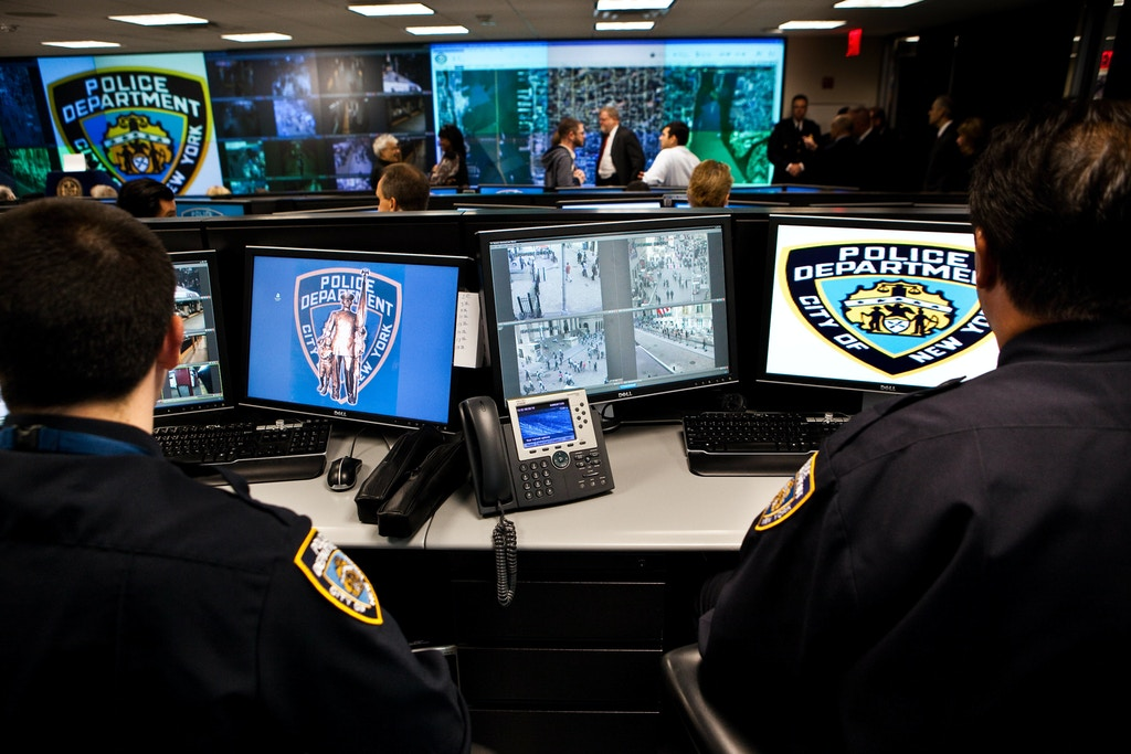 "A rare look inside the New York Police Department's lower Manhattan security center, where cops monitor surveillance cameras, environmental sensors and license plate readers around the clock. Mayor Michael Bloomberg and Police Commissioner Ray Kelly announced that subway cameras are also being monitored in the center -- officially called The Lower Manhattan Security Coordination Center. Modeled after London's ""Ring of Steel,"" the NYPD opened its coordination center in 2008. Today cops monitorfeeds from over 1159 CCTV cameras with the number increasing to 3,000 as the program expands. (Photo by Timothy Fadek/Corbis via Getty Images)"
