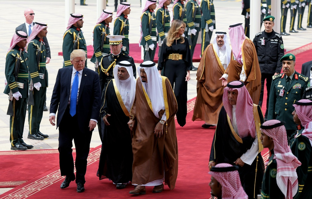 US President Donald Trump (L) is welcomed by Saudi King Salman bin Abdulaziz al-Saud (C) upon arrival at King Khalid International Airport in Riyadh on May 20, 2017, followed by First Lady Melania Trump (C-R). / AFP PHOTO / MANDEL NGAN (Photo credit should read MANDEL NGAN/AFP/Getty Images)