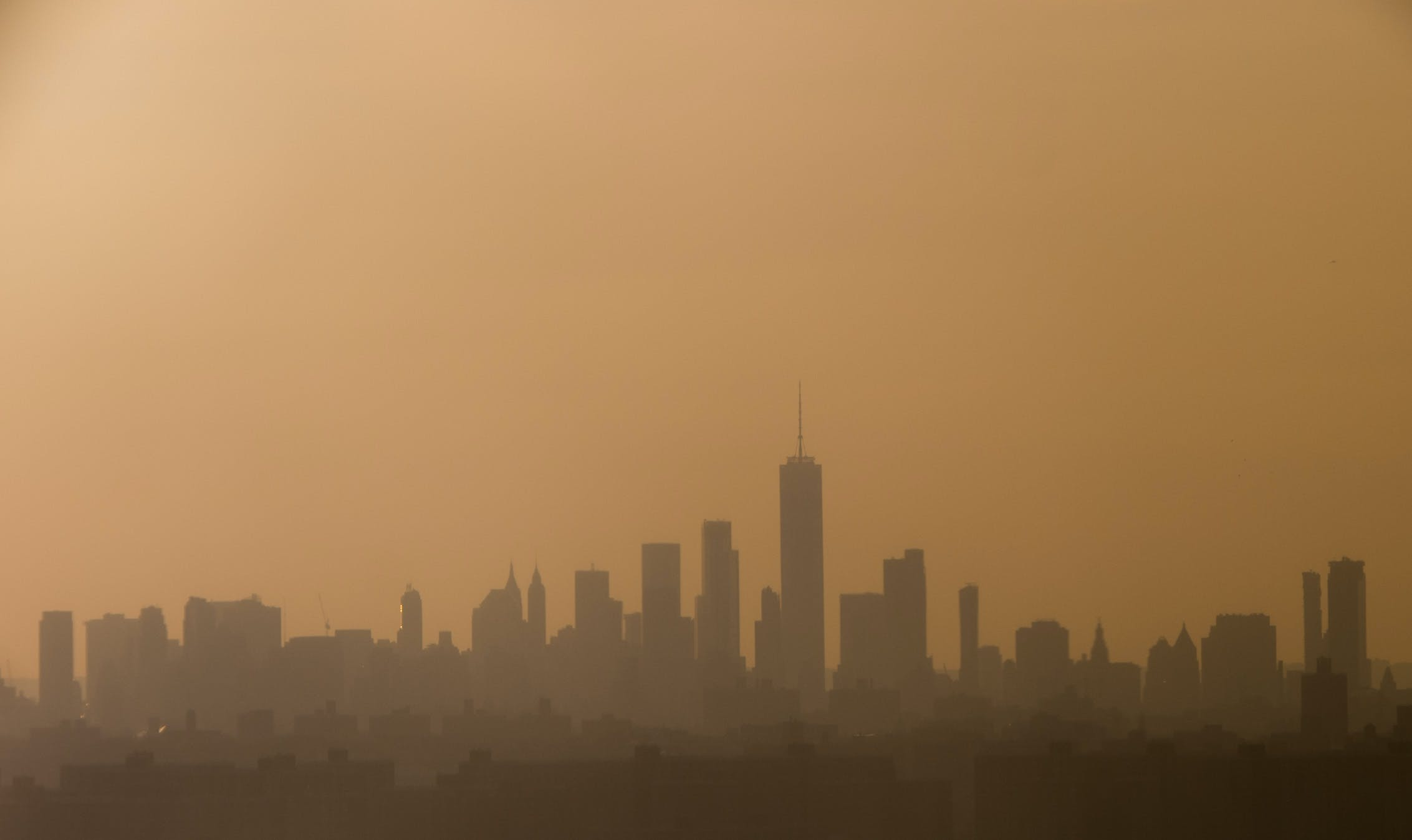 The skyline of Manhattan is seen at sunset in New York, May 23, 2018. (Photo by SAUL LOEB / AFP)        (Photo credit should read SAUL LOEB/AFP/Getty Images)