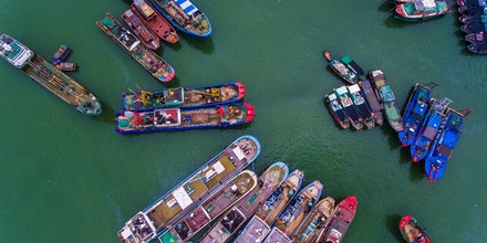 SANYA, CHINA - AUGUST 16: Fishing boats set sail from a harbor to catch fish in the South China Sea on August 16, 2017 in Sanya, Hainan Province of China. About 18,000 fishing boats set sail from Hainan to South China Sea for fishing on Wednesday. (Photo by Luo Yunfei/CHINA NEWS SERVICE/VCG via Getty Images)