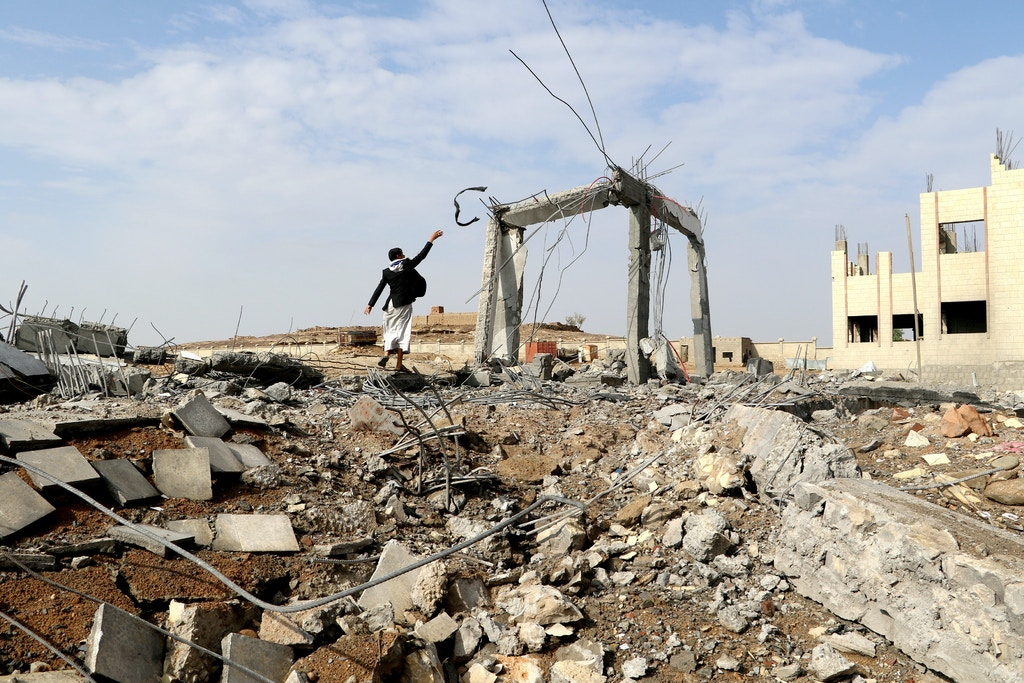 A man is seen at the site of an airstrike that destroyed the Community College in Saada, Yemen April 12, 2018. REUTERS/Naif Rahma - RC1B18DAE900