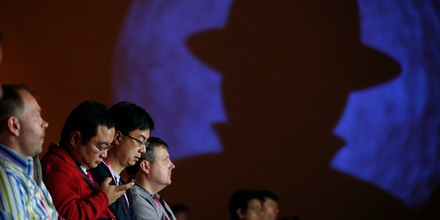People attend a presentation on hacking a city during the Black Hat conference Thursday, Aug. 6, 2015, in Las Vegas. The annual computer security conference draws thousands of hackers and security professionals to Las Vegas. (AP Photo/John Locher)