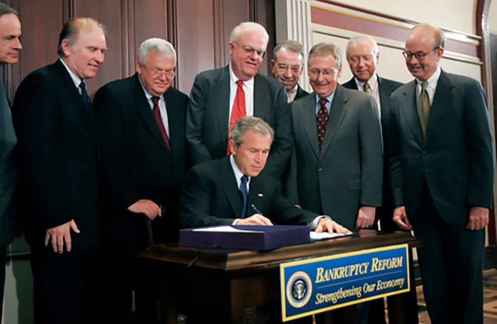 1425 President Bush: Legislative Affairs Pre-Brief for Signing of S. 256, the Bankruptcy Abuse Prevention and Consumer Protection Act of 2005.  President George W. Bush signs into law S.256, the Bankruptcy Abuse Prevention and Consumer Protection Act of 2005, Wednesday, April 20, 2005, at the Eisenhower Executive Office Building.  Culminating an eight-year effort to reform the laws, S.256 makes it harder for people to wipe out their debts after liquidating assets.  Watching on, from left are: