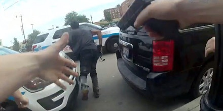 This frame grab from police body cam video provided by the Chicago Police Department shows authorities trying to apprehend a suspect, center, who appeared to be armed, Saturday, July 14, 2018, in Chicago. The suspect was fatally shot by police during the confrontation. (Chicago Police Department via AP)