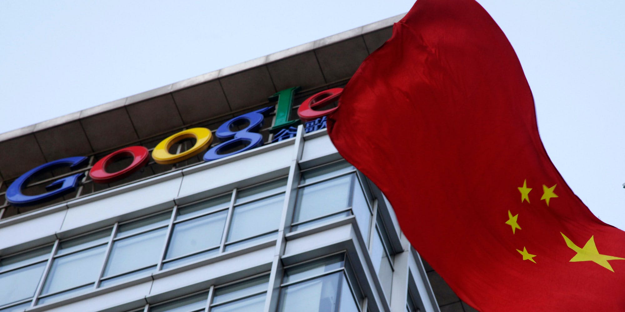 A Chinese flag flutters near the Google logo on top of Google's China headquarters in Beijing, China, Friday, Jan. 22, 2010. U.S. Secretary of State Hillary Rodham Clinton on Thursday urged China to investigate cyber intrusions that led search angle Google to threaten to pull out of that country, and challenged Beijing to openly publish its findings. (AP Photo/Ng Han Guan)