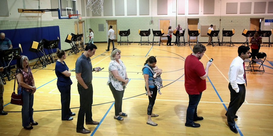 COLUMBUS, OH - AUGUST 07:  Voters in Ohio's 12th Congressional District wait in line to cast a ballot for their next congressman on August 7, 2018 in Columbus, Ohio. Democratic candidate Danny O'Connor is in a close race with Republican challenger Troy Balderson in today's special election.  (Photo by Scott Olson/Getty Images)