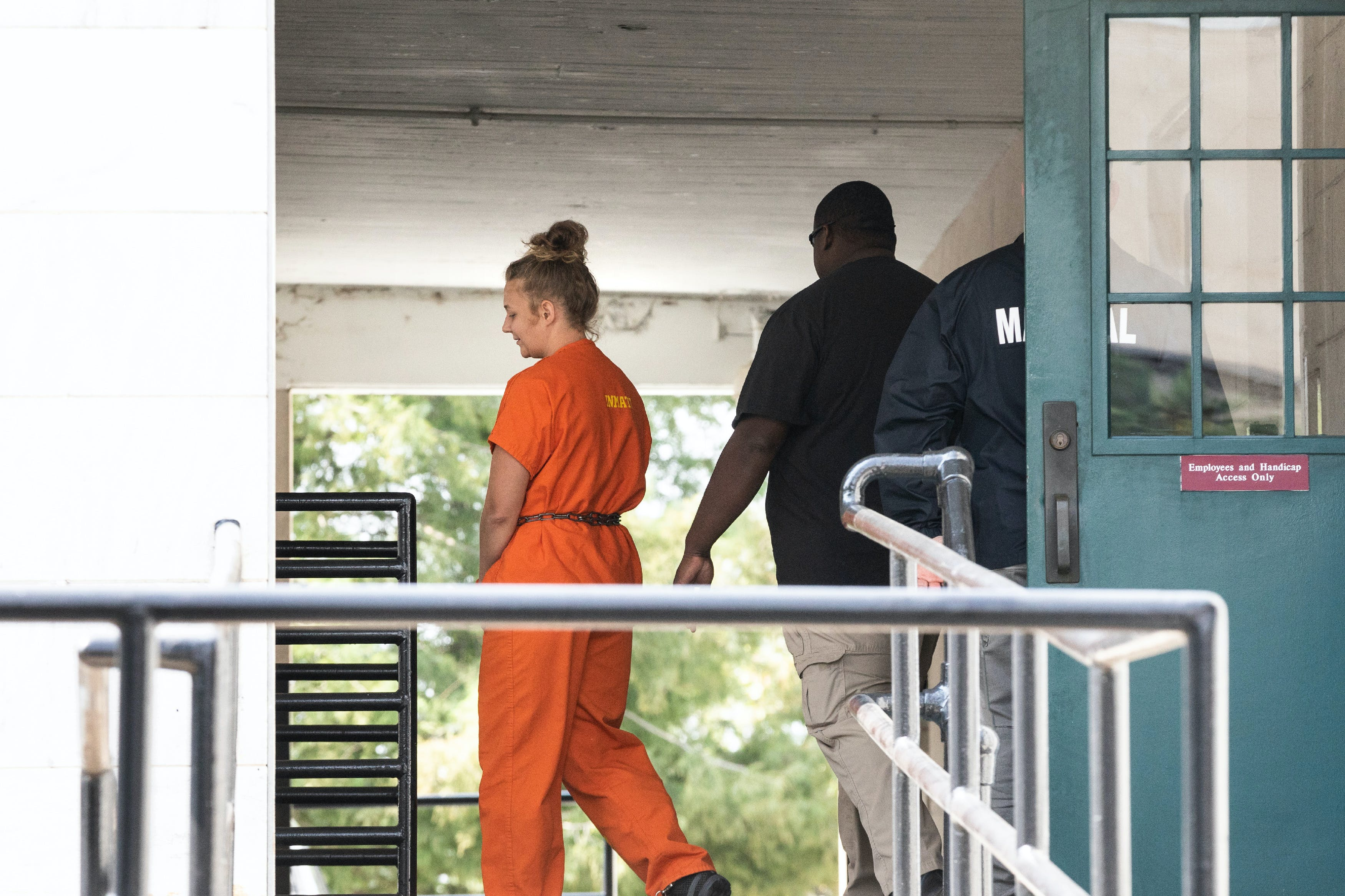 August 23, 2018, Augusta, Georgia, Reality Winner walks out of the courthouse after her sentencing.