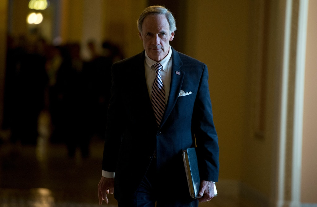 UNITED STATES - FEBRUARY 11: Sen. Tom Carper, D-Del., walks to the Senate floor on Tuesday, Feb. 11, 2014. (Photo By Bill Clark/CQ Roll Call)