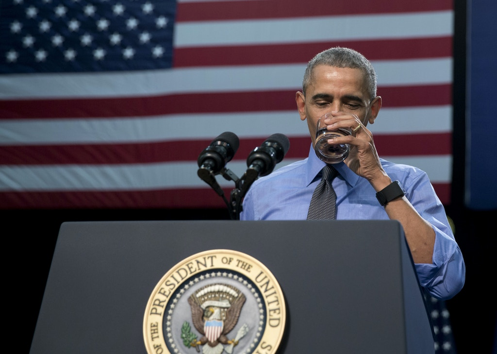 President Barack Obama drinks water as he speaks at Flint Northwestern High School in Flint, Mich., Wednesday, May 4, 2016, about the ongoing water crisis. (AP Photo/Carolyn Kaster)