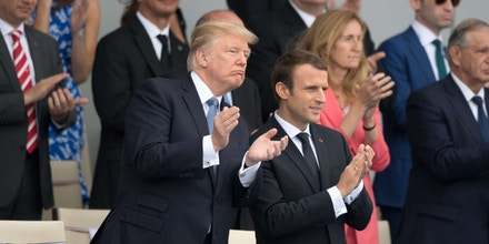French President Emmanuel Macron and U.S. President Donald Trump attend the traditional Bastille Day military parade on the Champs-Elysees in Paris, France, July 14, 2017. President Trump and the first lady are in France to attend the Bastille day celebrations (Sipa via AP Images)