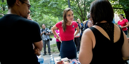 In this Wednesday, Aug. 15, 2018 photo, Democratic New York State Senate candidate Julia Salazar, center, speaks to supporters before a rally in McCarren Park in the Brooklyn borough of New York. Salazar is taking on 16-year-incumbent Sen. Martin Dilan in Brooklyn's 18th District on Thursday, Sept. 13. (AP Photo/Mary Altaffer)
