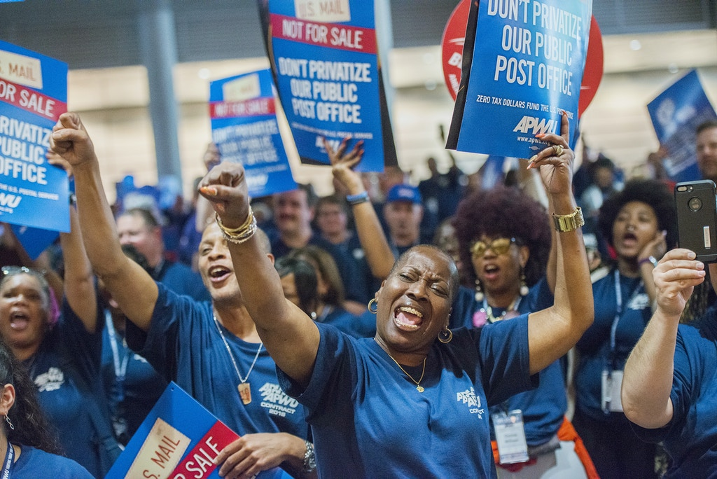 Nannette Corley, President of American Postal Workers Union Montgomery County Area Local, Gaithersburg, Md., chants with other supporters during an APWU rally at David Lawrence Convention Center Tuesday, Aug 21, 2018, in downtown Pittsburgh. The group protested the Trump administration's efforts to privatize the U.S. Postal Service. (Lake Fong/Pittsburgh Post-Gazette via AP)