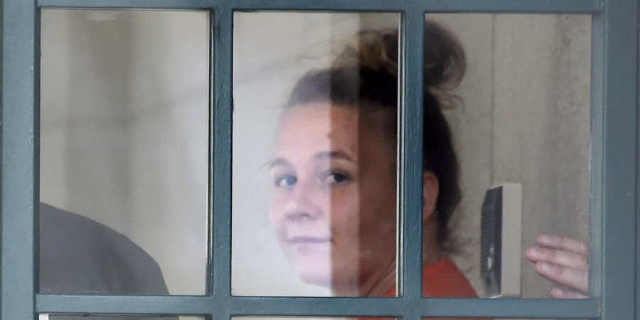 Reality Winner, who pleaded guilty to mailing a classified U.S. report to a news organization, walks out of a courthouse in Augusta, Ga., Thursday, Aug. 23, 2018, after being sentenced to more than five years in prison. (Michael Holahan/The Augusta Chronicle via AP)