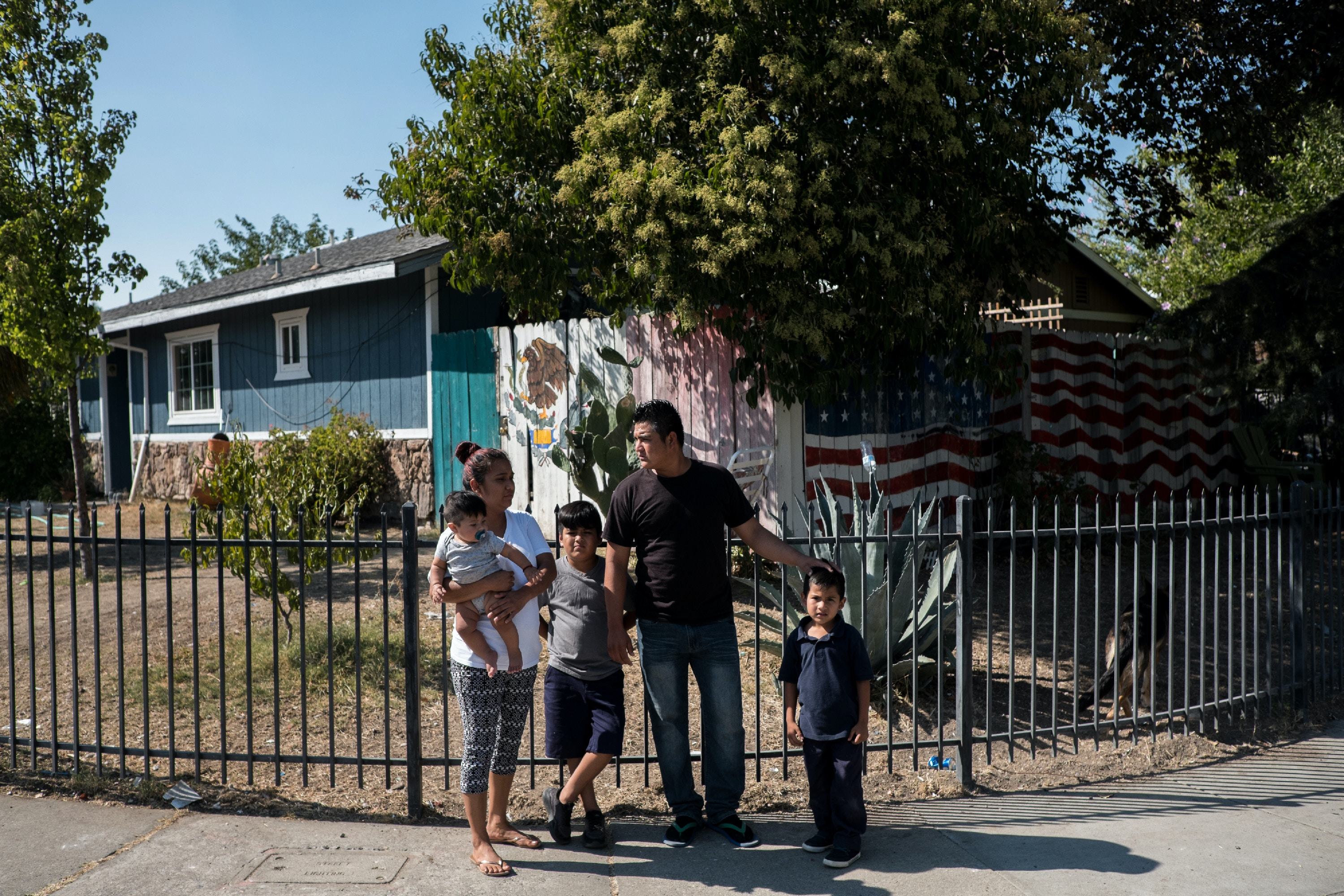Carlos Rueda Cruz, 28, second from right, poses for a portrait with his family outside their home in Sacramento, Calif., Monday, Sept. 10, 2018. (Joel Angel Juárez for The Intercept)