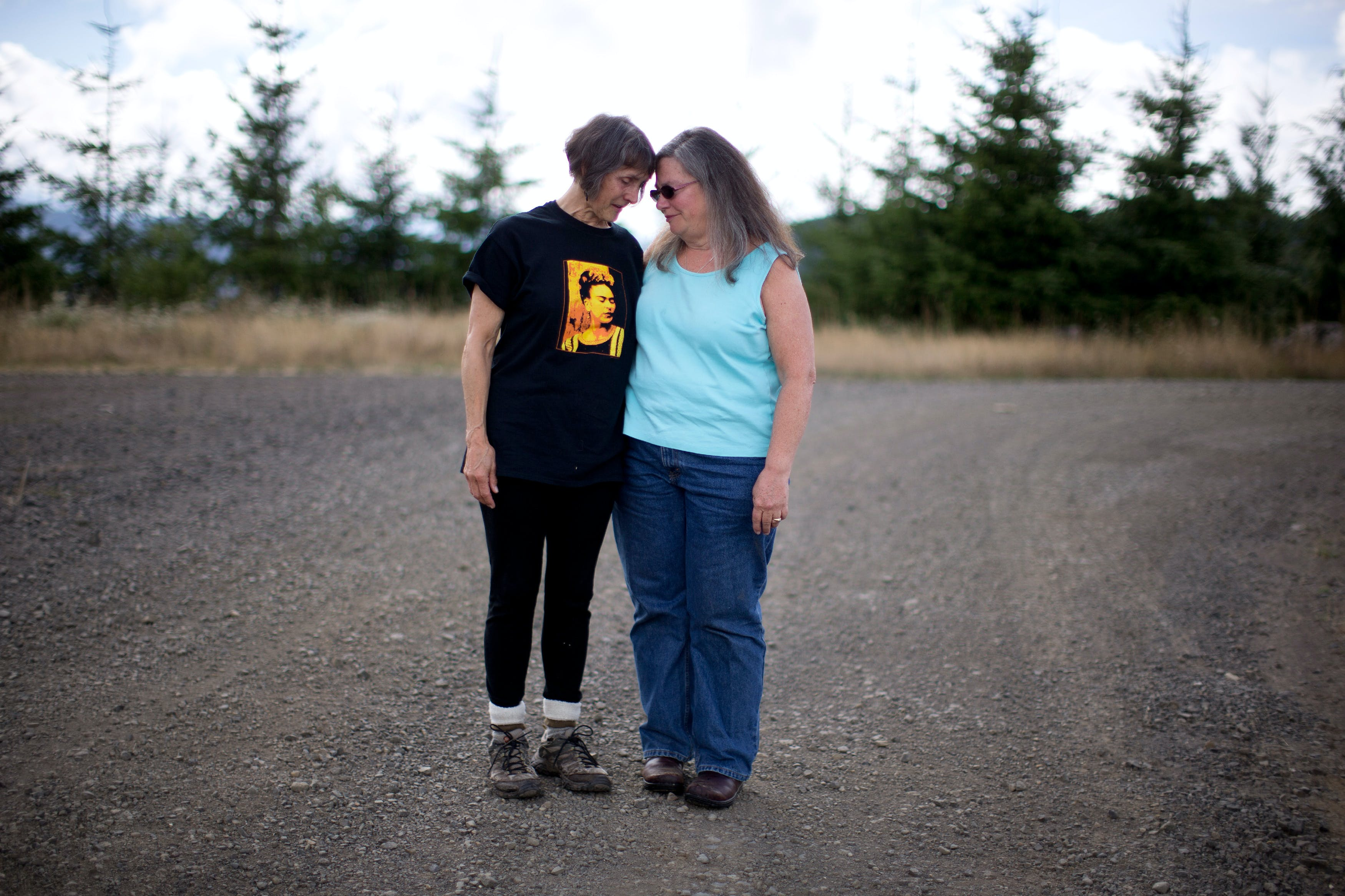 OREGON COAST, OR - SEPTEMBER 8: Barbara Davis, left, gathers support from Debra Fant, right, after becoming emotional at the sight of clear cutting of old growth timber along the coastal mountain range of Oregon. The two are part of the group Lincoln County Community Rights, who were able to get an ordinance passed to stop the aerial spraying of pesticides. September 8, 2018 (Photo by Beth Nakamura For The Intercept)