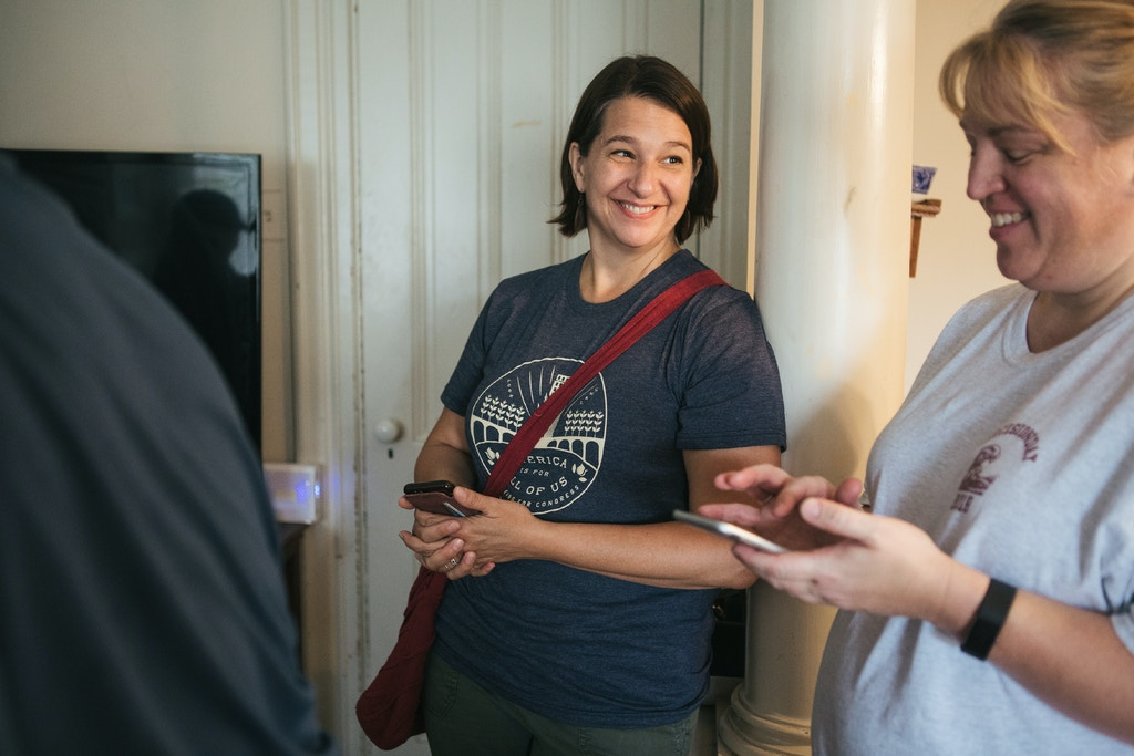 Jess King, a first-time Congressional candidate, smiles with volunteer canvassers before heading out to help canvass door-to-door in Mount Joy, Pennsylvania on Saturday, August 18, 2018. King, who lives in nearby Lancaster, is running for Congress in Pennsylvania's 11th District.(Michelle Gustafson for The Intercept)
