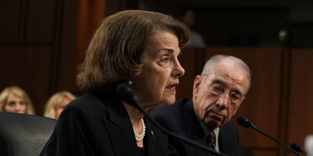 WASHINGTON, DC - JULY 24: U.S. Sen. Dianne Feinstein (D-CA) (L) and Sen. Chuck Grassley (R-IA) (R) testify during a hearing before the Consumer Protection, Product Safety, Insurance, and Data Security Subcommittee of Senate Commerce, Science, and Transportation Committee July 24, 2018 on Capitol Hill in Washington, DC. The hearing was to focus on changes made by the United States Olympic Committee (USOC), USA Gymnastics (USAG), and Michigan State University (MSU) to protect Olympic and amateur athletes from abuse.  (Photo by Alex Wong/Getty Images)