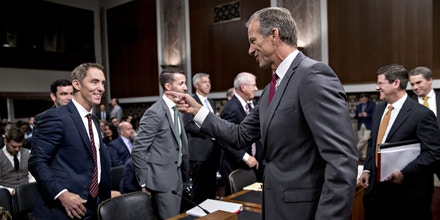 Senator John Thune, a Republican from South Dakota and chairman of the Senate Commerce Committee, right, greets Keith Enright, chief privacy officer with Google Inc., left, during a hearing on consumer data privacy in Washington, D.C., U.S., on Wednesday, Sept. 26, 2018. Facing growing pressure to protect their customers' privacy, some of the biggest technology companies told Congress that they favor new federal consumer safeguards but diverged on some of the details. Photographer: Andrew Harrer/Bloomberg via Getty Images