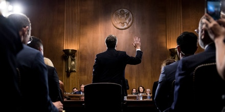 TOPSHOT - US Supreme Court nominee Judge Brett Kavanaugh is sworn in before testifying at the Senate Judiciary Committee on Capitol Hill in Washington, DC, on September 27, 2018. - University professor Christine Blasey Ford, 51, told a tense Senate Judiciary Committee hearing that could make or break Kavanaugh's nomination she was