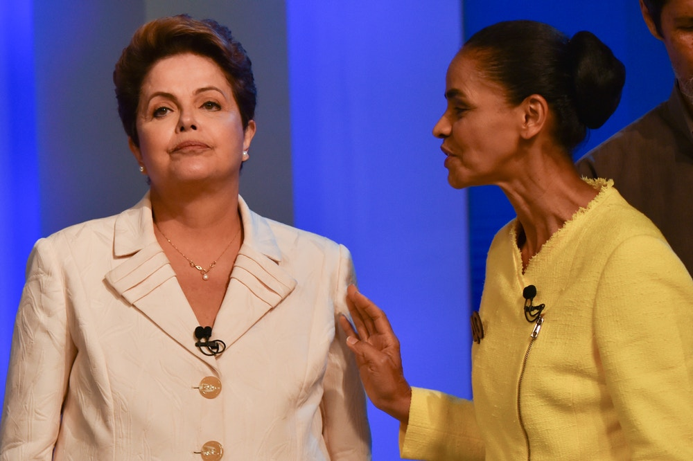 Brazilian President and candidate of Brazilian presidential election for the Workers Party (PT) Dilma Rousseff (L) and Marina Silva, a candidate for the Brazilian Socialist Party (PSB), attend their last TV debate in Rio de Janeiro, Brazil, on October 2, 2014. The general election will be held on October 5, 2014.  AFP PHOTO / YASUYOSHI CHIBA        (Photo credit should read YASUYOSHI CHIBA/AFP/Getty Images)