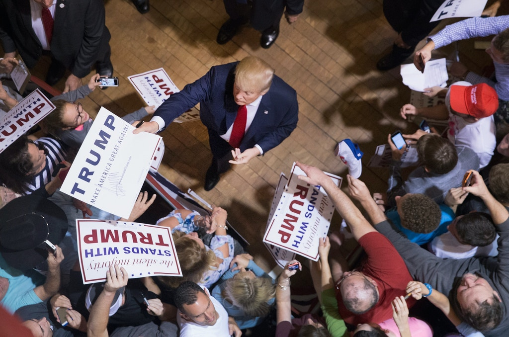 BURLINGTON, IA - OCTOBER 21: Republican presidential candidate Donald Trump greets guests after speaking at a campaign rally at Burlington Memorial Auditorium on October 21, 2015 in Burlington, Iowa. Trump leads most polls in the race for the Republican presidential nomination. (Photo by Scott Olson/Getty Images)