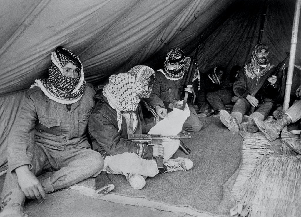 BAQUAR, JORDAN:  Fatah militiamen rest under a tent close to the Jordan river in Jordan 04 November 1969. After Israeli army started a lightning war in Syria, Sinan and Jordan in June 1967 the problem of Palestinian refugees increased without precedent in the Arab countries around Israel. Des militants du Fatah se reposent sous une tente prFs de la rive jordanienne du Jourdain le 04 novembre 1969. A la suite de la guerre-Tclair lancTe par l'armTe israTlienne en Syrie, dans le Sinan et en Jordanie en juin 1967, le problFme des rTfugiTs palestiniens a pris une ampleur sans prTcTdent dans les pays arabes entourant Isradl. (Photo credit should read AFP/AFP/Getty Images)