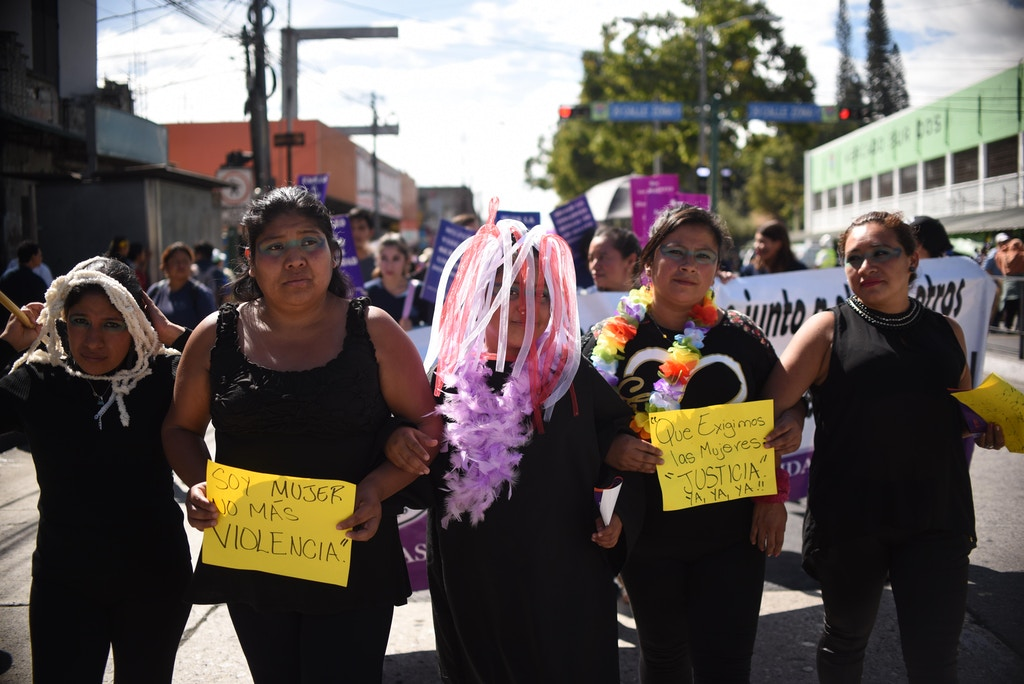 Women dressed in black take part in the commemoration of the International Day for the Elimination of Violence Against Women in Guatemala City, Guatemala, on Nov. 25, 2016.  According to a UN report released on Thursday, 625 women have died due to violent events in Guatemala this year. / AFP / JOHAN ORDONEZ        (Photo credit should read JOHAN ORDONEZ/AFP/Getty Images)