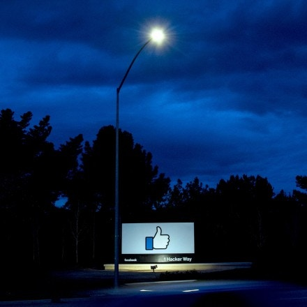 TOPSHOT - A car passes by Facebook's corporate headquarters location in Menlo Park, California, on March 21, 2018. Facebook chief Mark Zuckerberg vowed on March 21 to