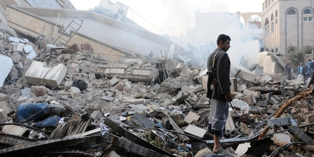 SANA'A, YEMEN – JUNE 06: A man stands on rubble of a building destroyed in airstrikes carried out by warplanes of the Saudi-led coalition hours after the UN Special Envoy to Yemen Martin Griffiths departed Sana'a on June 06, 2018 in Sana'a, Yemen.  (Photo by Mohammed Hamoud/Getty Images)