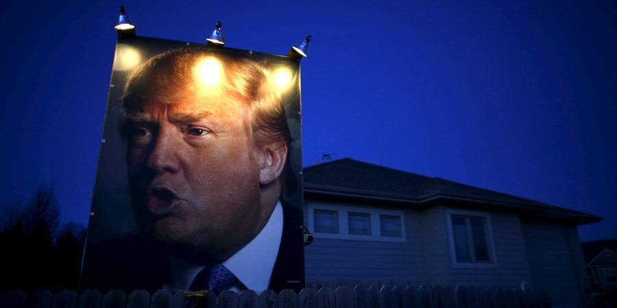 A picture of U.S. Republican presidential candidate Donald Trump hangs outside a house in West Des Moines, Iowa, United States, January 15, 2016.    REUTERS/Jim Young        TPX IMAGES OF THE DAY      - GF20000096420
