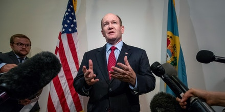 Sen. Chris Coons, D-Del., speaks to reporters after his meeting with President Donald Trump's Supreme Court nominee, Judge Brett Kavanaugh, on Capitol Hill in Washington, Thursday, Aug. 23, 2018. Sen. Coons, a member of the Senate Judiciary Committee which will oversee Kavanaugh's confirmation, says he does not think the committee should go forward with the scheduled September 4th hearings. (AP Photo/J. Scott Applewhite)