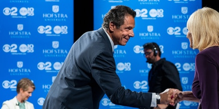 New York Gov. Andrew Cuomo shakes hands with a moderator as opponent Cynthia Nixon prepares before a debate at Hofstra University Aug. 29, 2018 in Hempstead, N.Y.