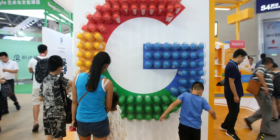 CHONGQING, CHINA - AUGUST 23: People visit the Google pavilion during the Smart China Expo at Chongqing International Expo Center on August 23, 2018 in Chongqing, China. The first Smart China Expo with the theme of 'Smart Technology: Empowering Economy, Enriching Life' is held on August 23-25 in Chongqing. (Photo by VCG/VCG via Getty Images)