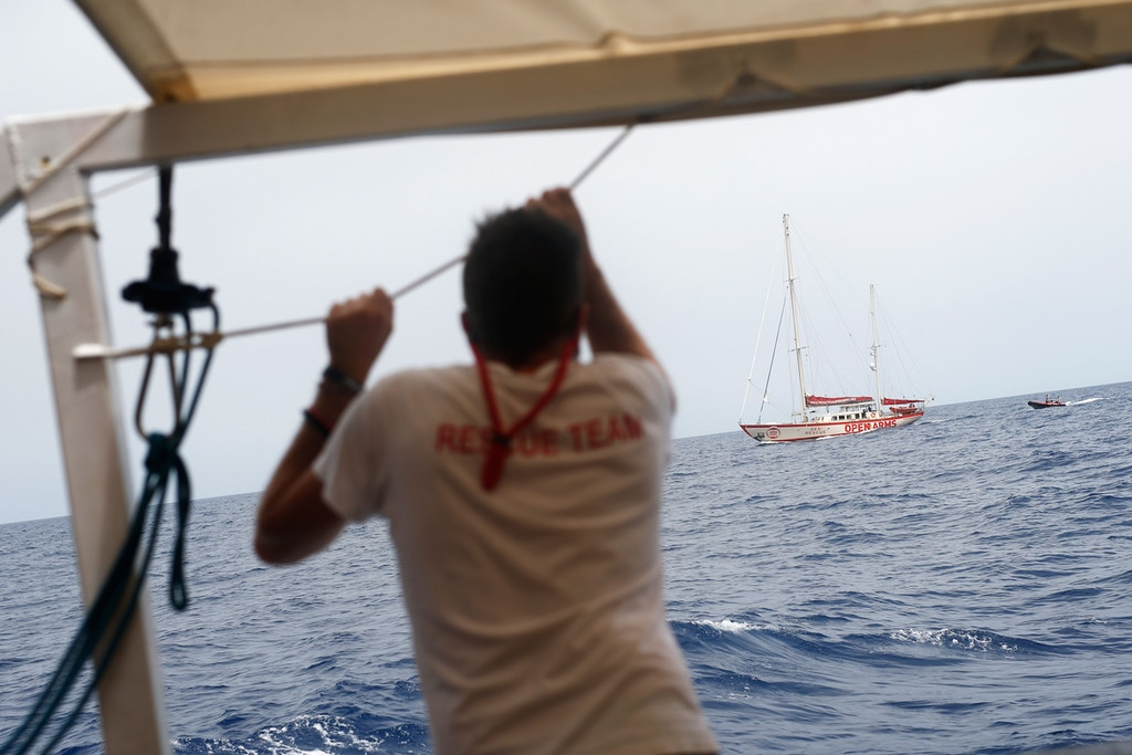 A member of the Spanish NGO Proactiva Open Arms looks out as they sail along the Mediterranean sea, on July 17, 2018 some 90 kilometers from the Spanish coast.