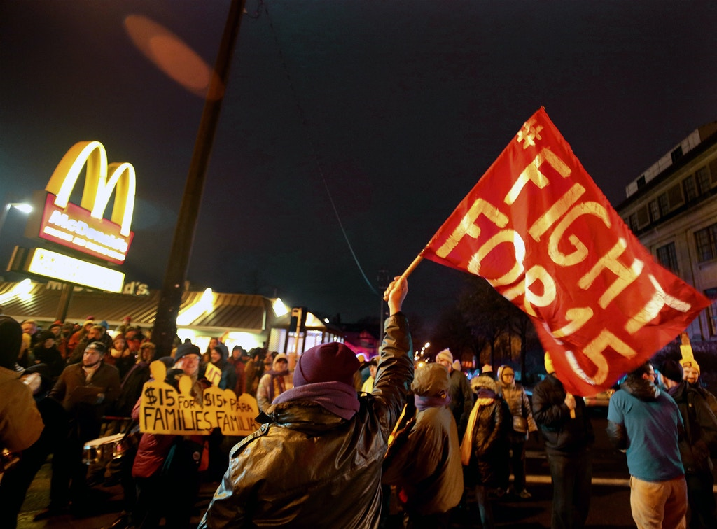FILE - In this Nov. 29, 2016 file photo, protesters gather outside a McDonald's restaurant in Minneapolis during a demonstration for higher wages as part of the National Day of Action to Fight for $15. On Tuesday, May 22, 2018, Fight for $15 is announcing that it's helping women in several U.S. cities to file complaints with the U.S. Equal Employment Opportunity Commission alleged they experienced sexual harassment while working at McDonald's. (David Joles/Star Tribune via AP, File)